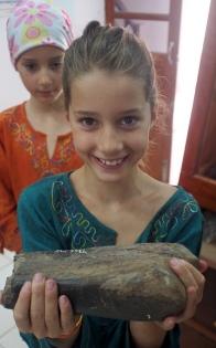 Jemima Holding a T-Rex Bone