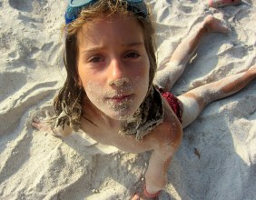 Evie: Completely happy in the white sand
