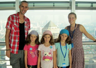 Family shot at the Skybridge, Petronas Towers (L-R Ferg, Scar,ett, Evie, Jemima, Janet)