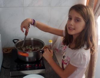 Evie making spaghetti bolognaise